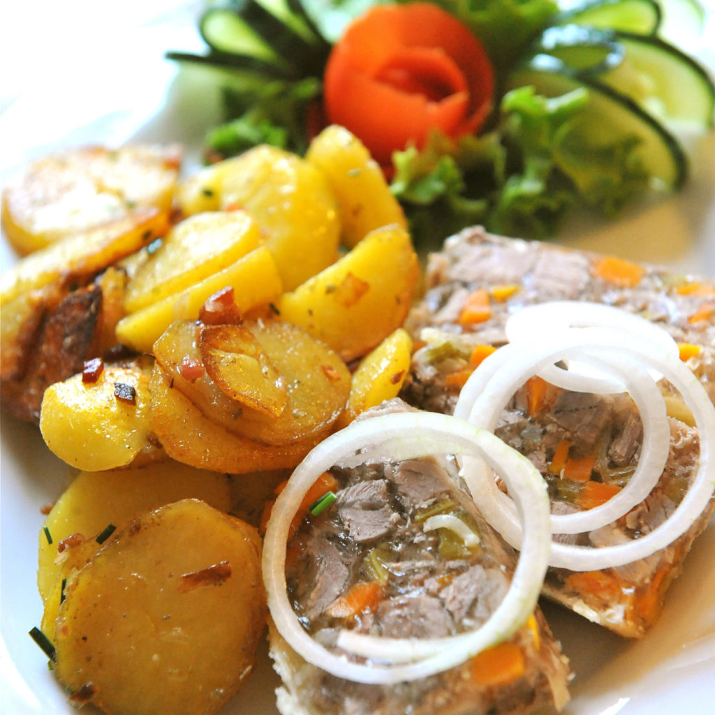 Potato dish with sausage and salad