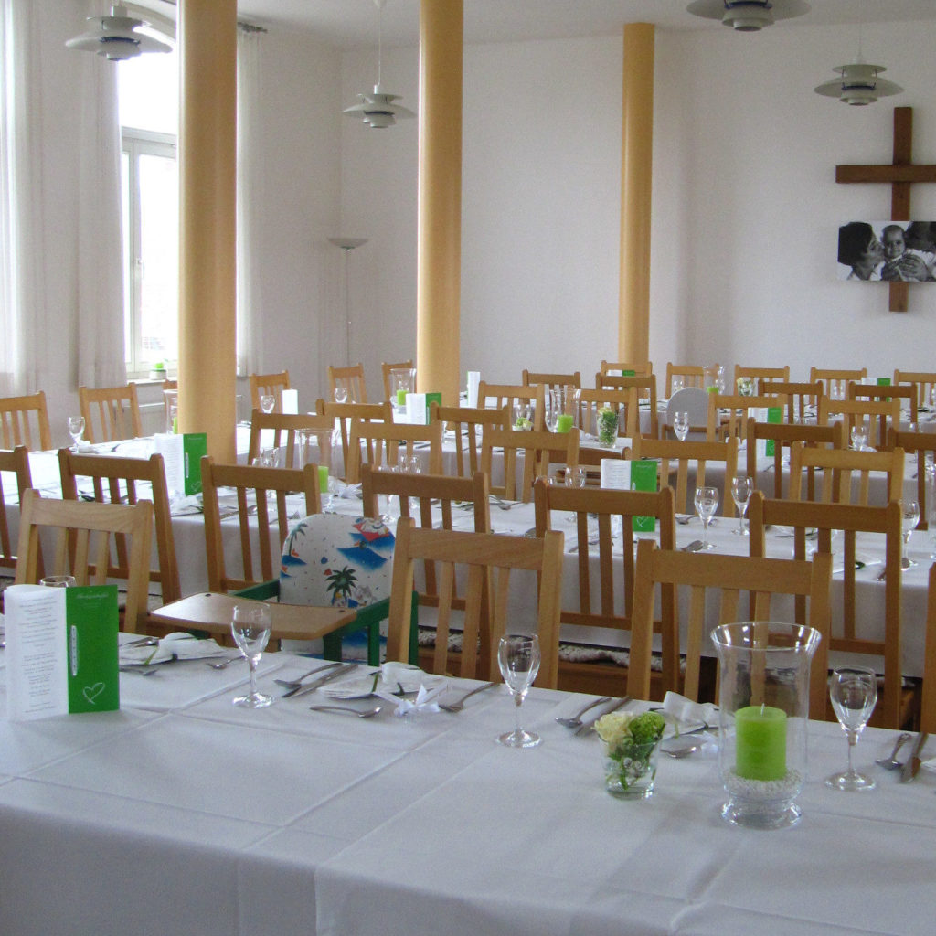 Covered table rows in hall with cross