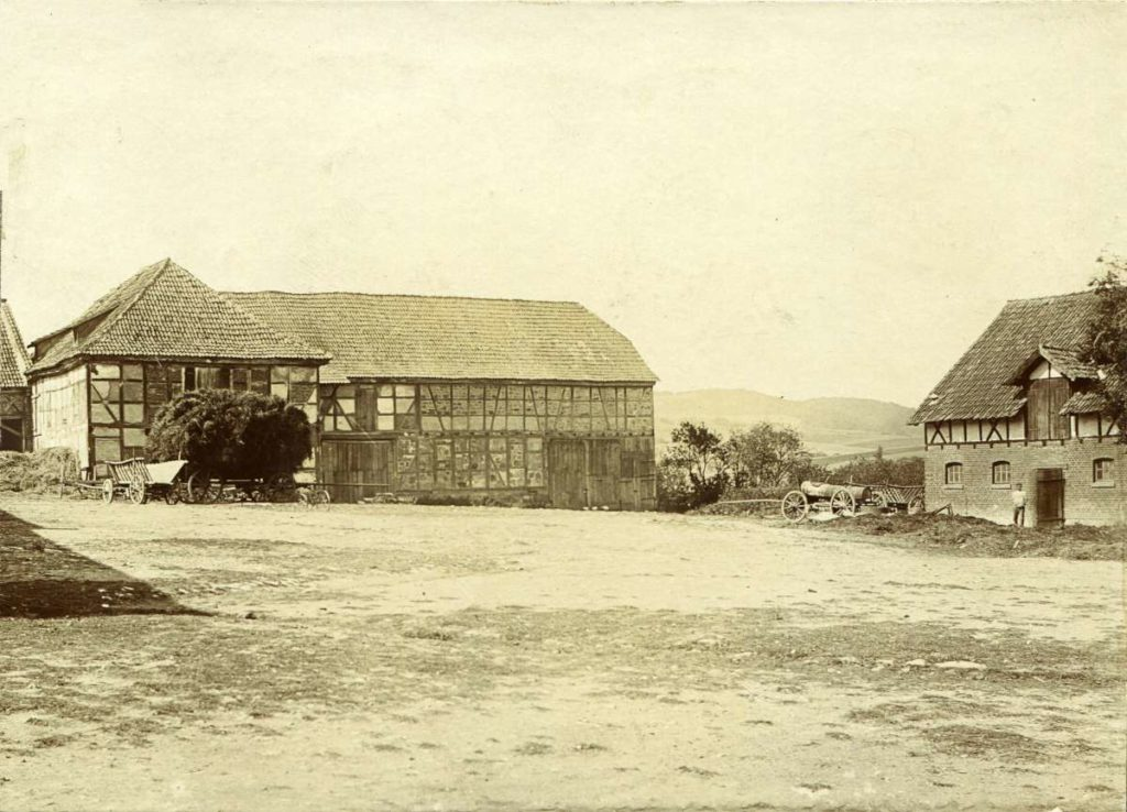 Barn and cowshed with hay cart