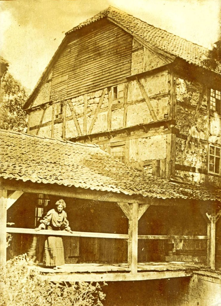 Manor house water mill with woman