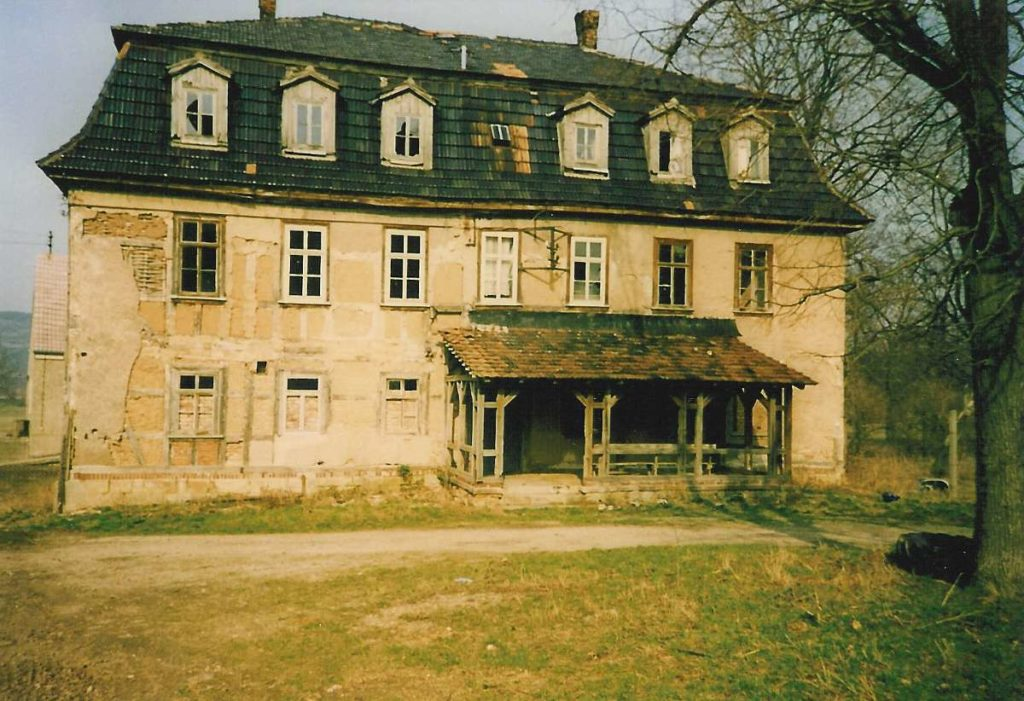 Manor house with veranda and old facade